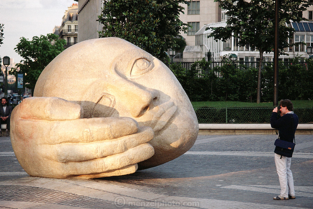 Sculpture of head L 'Ecoute by Henri de Miller located outside St Eustache church at Les Halles, Paris, France.