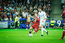 Andy Robertson of Liverpool vs Cristiano Ronaldo of Real Madrid during the UEFA Champions League final football match between Liverpool and Real Madrid at the Olympic Stadium in Kiev, Ukraine on May 26, 2018.Photo by Sandi Fiser / Sportida