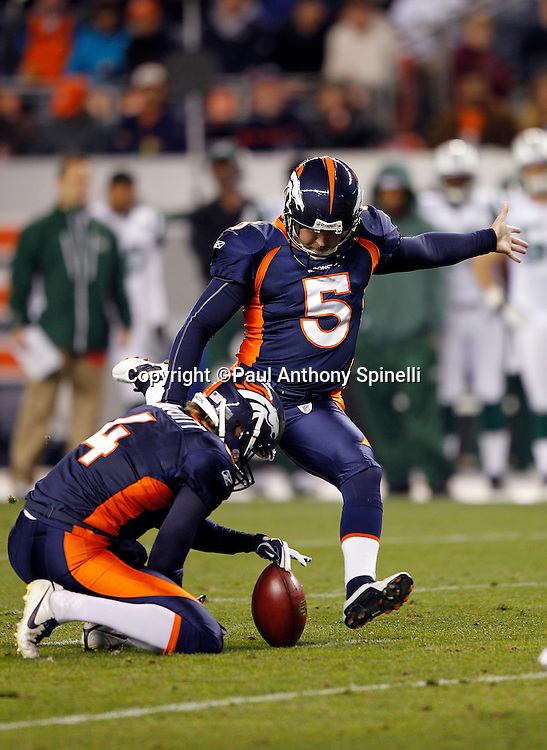 Denver Broncos kicker Matt Prater (5) kicks a first quarter field goal that gives the Broncos a 3-0 lead during the NFL week 11 football game against the New York Jets on Thursday, November 17, 2011 in Denver, Colorado. The Broncos won the game 17-13. ©Paul Anthony Spinelli