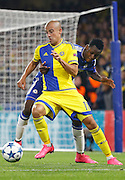 Baba Rahman holds off Tal Ben Haim II  and keeps him from attacking the Chelsea goal during the Champions League match between Chelsea and Maccabi Tel Aviv at Stamford Bridge, London, England on 16 September 2015. Photo by Andy Walter.