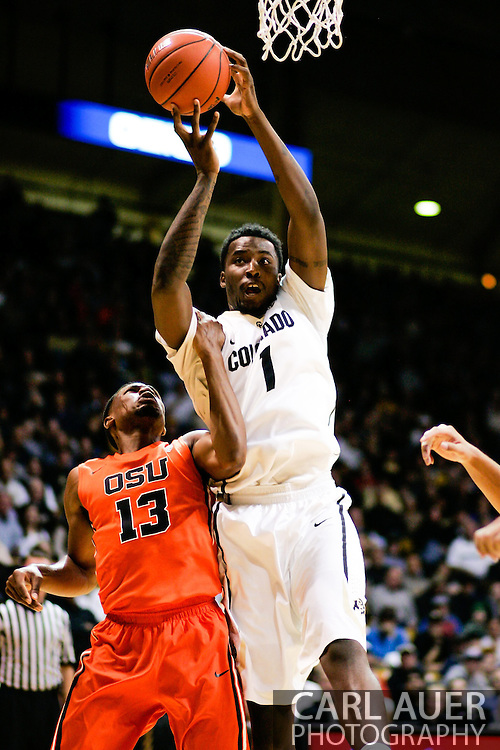 January 2nd, 2014:  Colorado Buffaloes redshirt freshman forward Wesley Gordon (1) is fouled by Oregon State Beavers sophomore guard Langston Morris-Walker (13) as he puts up a shot in the second half of the NCAA Basketball game between the Oregon State Beavers and the University of Colorado Buffaloes at the Coors Events Center in Boulder, Colorado
