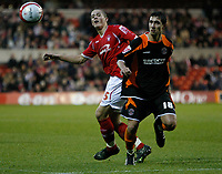 Photo: Richard Lane/Richard Lane Photography. Nottingham Forest v Blackpool. Coca Cola Championship. 13/12/2008. Chris Cohen (L) tries to turn Joe Martin (R)