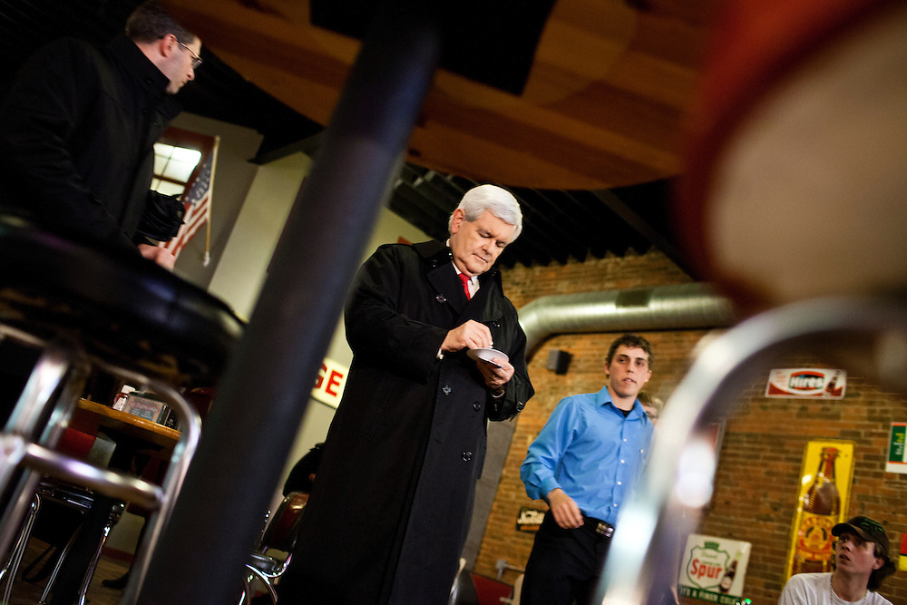 Republican presidential candidate Newt Gingrich leaves after speaking to supporters at Smokey Row Coffee House on Tuesday, December 20, 2011 in Oskaloosa, IA.