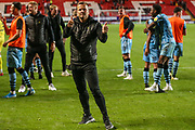 Forest Green Rovers manager, Mark Cooper applauds the fans at the end of the match during the EFL Cup match between Charlton Athletic and Forest Green Rovers at The Valley, London, England on 13 August 2019.
