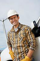 Engineer by van at wind farm, portrait
