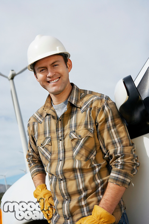 Engineer by van at wind farm, portrait