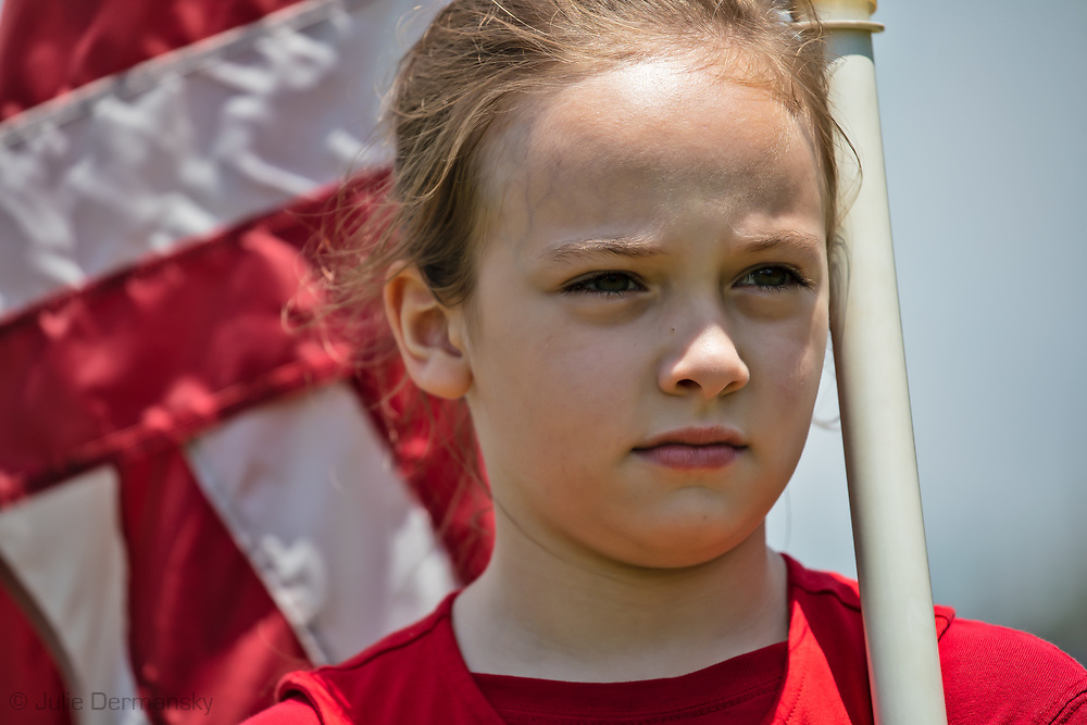 "Young girl at a ""Save America Rally"" in Baton Rouge on the 4th of July across the street from the Governor's Mansion where about 200 gathered. The 4th of July rally was organized by Jeff Crouer, Mimi Owens and Woody Jenkins, chairman of the executive committee for the Republican Party in East Baton Rouge Parish. Rev. Tony Spell of Life Tabernacle Church who has held church services in defiance of a stay-at-home order throughout the pandemic was one of the speakers. He an other speakers expressed their displeasure of being told to wear a mask to prevent the spread of Covid-19 and the removal of confederate monuments."