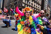 New York, NY - 30 June 2019. The New York City Heritage of Pride March filled Fifth Avenue for hours with participants from the LGBTQ community and it's supporters. A very colorful paticipant, wearing all the rainbow colors.