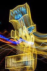 """Tahoe Lights 6"" - Photograph taken at the Lake Tahoe northern state line casinos. The look was achieved by shooting a handheld long exposure and zooming the lens during the exposure."