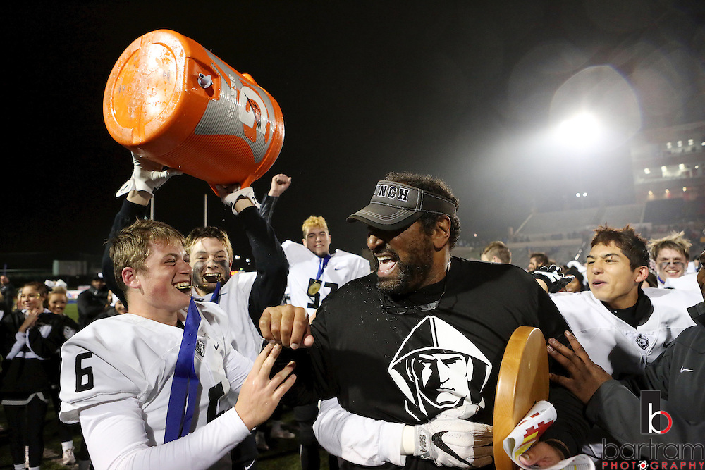 Bishop Lynch quarterback Alec Ralph celebrates with head coach Chuck Faucette following the TAPPS Division I state championship game on Saturday, Dec. 3, 2016 at Panther Stadium in Hewitt, Texas. Bishop Lynch High School won 21-17. (Photo by Kevin Bartram)