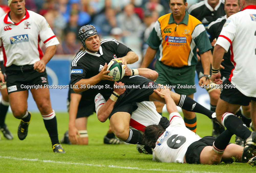 Schalk Brits gets tackled during the opening round of the 2006 Super 14 rugby union match between the Cats and the Stormers at Ellis Park, Johannesburg, South Africa on 11 February 2006. The Stormers won 23-12. Photo: Africa Visuals/PHOTOSPORT.  #NO AGENTS# NZ USE ONLY#