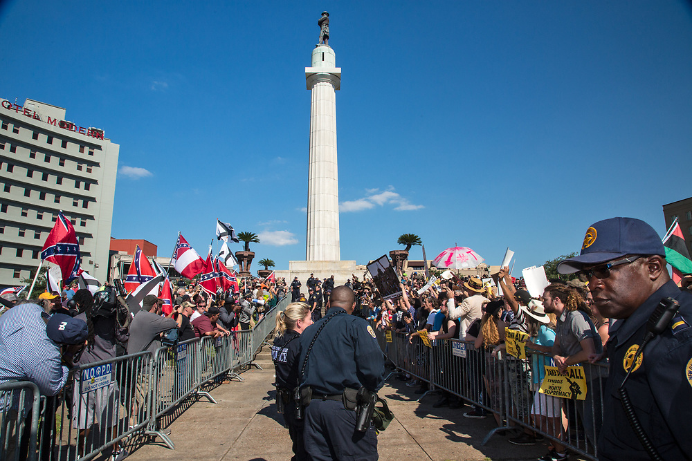 Police try to keep pro Confederate and Anit- Confederate monument supports apart in Lee's Circle in New Orleans.