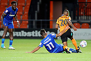 AFC Wimbledon attacker Harry Forrester (11) sliding tackle on Barnet midfielder Mauro Vihete (20) during the EFL Trophy match between Barnet and AFC Wimbledon at Underhill Stadium, London, England on 29 August 2017. Photo by Matthew Redman.