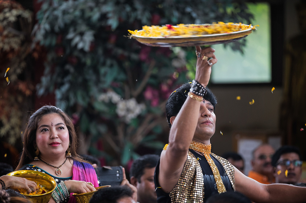 A man performs with larges trays at the 6th Ganesha Festival at Utthyan Ganesha Temple, Nakhon Nayok, Thailand.