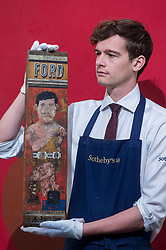 """© Licensed to London News Pictures. 16/11/2018. LONDON, UK. A technician presents """"Strong Man 1"""", 1957, by Sir Peter Blake (Est. GBP150,000-250,000). Preview of Sotheby's autumn sale of Modern & Post War British art.  Works from the British art scene of the past century will be offered for sale on 20 and 21 November 2018 at Sotheby's in London.  Photo credit: Stephen Chung/LNP"""