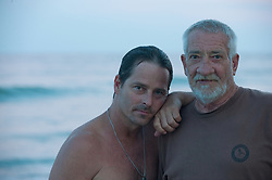 Portrait Of Father And Son At The Beach