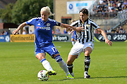 Chelsea Ladies midfielder Katie Chapman holds off Notts County Ladies forward Rachel Williams during the FA Women's Super League match between Chelsea Ladies FC and Notts County Ladies FC at Staines Town FC, Staines, United Kingdom on 6 September 2015. Photo by Mark Davies.