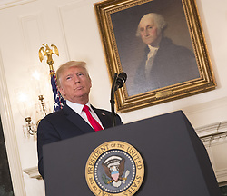 August 14, 2017 - Washington, District of Columbia, U.S. - United States President DONALD J. TRUMP walks in to the podium in the Diplomatic Reception Room to make a statement on the violence this past weekend at The White House. President Trump responded to pressure that he further condemn white supremacists and their actions in inciting violent demonstrations over the weekend, labeling their racist views 'evil.' (Credit Image: © Chris Kleponis/Pool/CNP via ZUMA Wire)