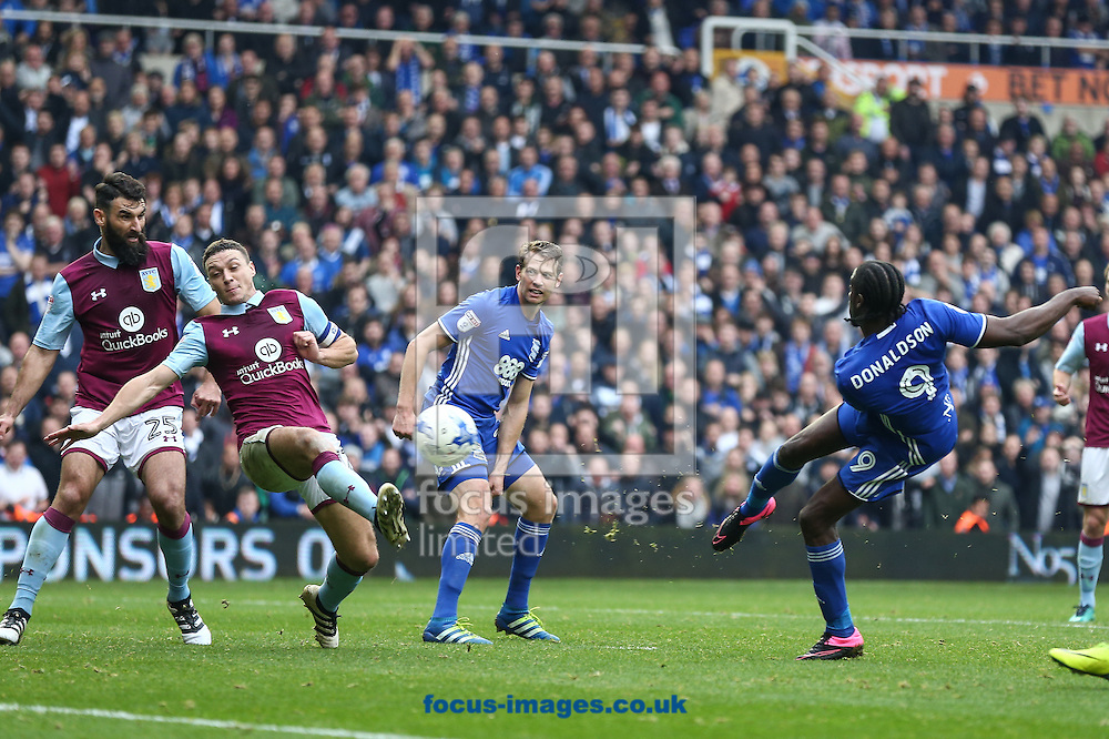 Clayton Donaldson of Birmingham City (right) shoots at goal during the Sky Bet Championship match at St Andrews, Birmingham<br /> Picture by Andy Kearns/Focus Images Ltd 0781 864 4264<br /> 30/10/2016
