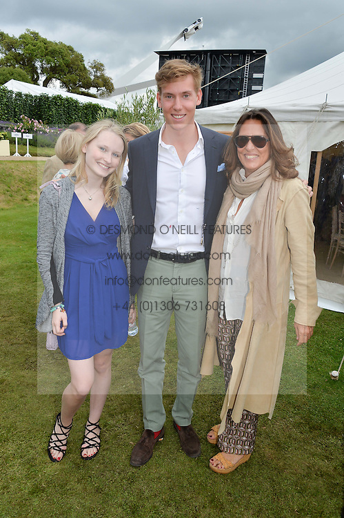 Left to right, ISABELLE SMURFIT, ALBERTO CARELLO and his mother SARA CARELLO at the Cartier hosted Style et Lux at The Goodwood Festival of Speed at Goodwood House, West Sussex on 26th June 2016.