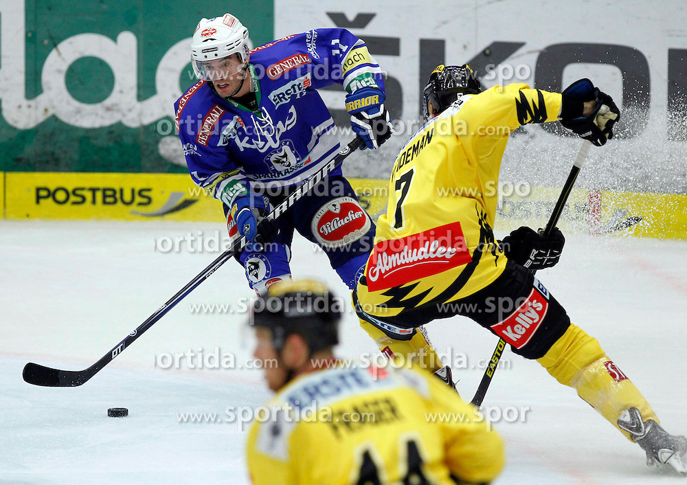 22.09.2013, Stadthalle, Villach, AUT, EBEL, EC VSV vs UPC Vienna Capitals, 9. Runde, im Bild Derek Ryan (VSV,#11) und Adrian Veideman (Capitals,#7) // during the Erste Bank Icehockey League 9th round between EC VSV vs UPC Vienna Capitals at the City Hall, Villach, Austria, 2013/09/22, EXPA Pictures © 2013, PhotoCredit: EXPA/ Oskar Hoeher