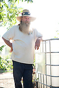 Paul Dowlearn poses for a portrait at Wichita Valley Nursery in Wichita Falls, Texas on October 7, 2014. Dowloearn has been collecting rain water to use for his plant nursery for nearly 20 years. (Cooper Neill for The Texas Tribune)