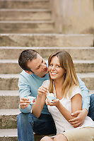 Couple sitting on steps Eating Gelato front view