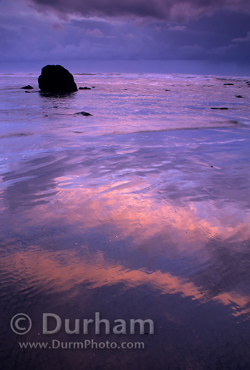 A basalt rock formation on the Oregon Coast at dusk with a rainstorm on the horizon. Cannon Beach, Oregon. 1998.