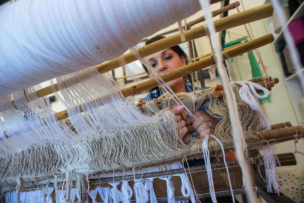 Chiaravalle, 03/07/2017: Chiara Pirroncello nel laboratorio di tessitura artigianale &quot;Universochiara&quot; dove i processi di lavorazione e rifinitura derivano da una antica tradizione familiare.<br /> &copy; Andrea Sabbadini