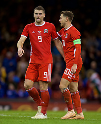 CARDIFF, WALES - Thursday, October 11, 2018: Wales' Sam Vokes (L) celebrates scoring a consolation goal with team-mate Aaron Ramsey during the International Friendly match between Wales and Spain at the Principality Stadium. Spain won 4-1. (Pic by David Rawcliffe/Propaganda)
