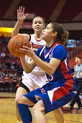 25 March 2010: Katie Broadway attempts to block a shot by Monica Engelman from the side. The Redbirds of Illinois State crush the Jayhawks of Kansas 71-51 during the 3rd round of the 2010 Women's National Invitational Tournament (WNIT) on Doug Collins Court inside Redbird Arena at Normal Illinois.