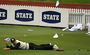 Matthew Bell holds onto a sheet of paperwork that blew away in the wind.<br /> National Bank Test Match Series, New Zealand v England, Black Caps Nets Practice. Allied Prime Basin Reserve, New Zealand. Tuesday, 11 March 2008. Photo: Dave Lintott/PHOTOSPORT