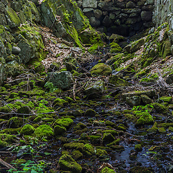 The remnants of an old stone mill dam at the outlet of Page Pond in Meredith, New Hampshire.