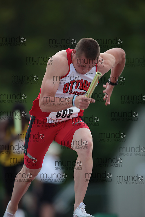 London, Ontario ---14/06/09---  Michael Robertson of Ottawa Lions T.F.C. competes in the  2009 AO Ontario Junior Championships at TD Waterhouse stadium in London, Ontario, June 13, 2009..GEOFF ROBINS Mundo Sport Images