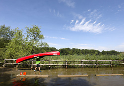 June 18, 2017 - Toronto, Ontario, Canada - TORONTO, ON - JUNE, 18   Mark Winter carries a canoe through the flooded road to the launch area..The 4th Annual Paddle the Rouge event that connects families in the GTA with nature, introduces them to the new Rouge National Urban Park and helps to conserve its ecological health is happening on Father's Day.  Dozens of canoes and kayaks were available for the public to try and use at the river front in the Port Union Road and Lawrence area..June 18, 2017 Richard Lautens/Toronto Star Richard Lautens/Toronto Star (Credit Image: © Richard Lautens/The Toronto Star via ZUMA Wire)