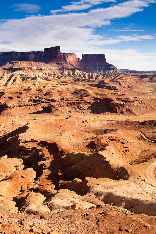 The rugged canyons of Canyonlands National Park extend in all directions as seen from The White Rim Trail above the Green River near Moab, Utah. The canyons have been cut over eons by water, wind and the elements creating a rugged landscape that are a playground for adventurers and hideaways for outlaws.