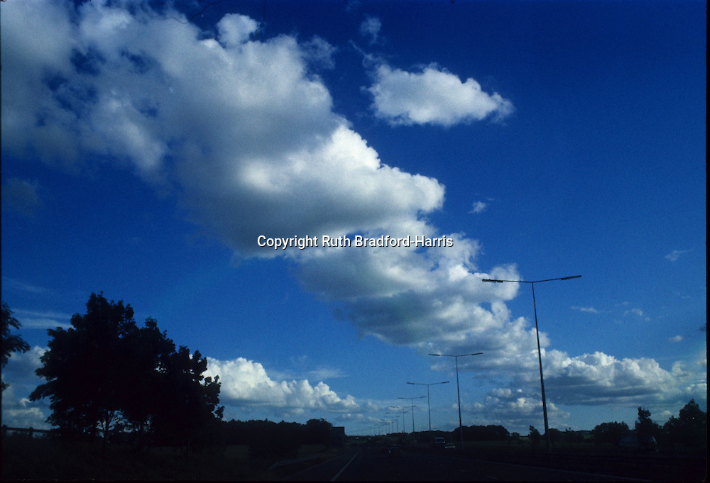 A strikingly dramatic cumulus 'cloud street' above the M6 motorway and seemingly following it into Cumbria!<br />