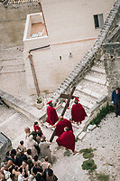 """MATERA, ITALY - 5 OCTOBER 2019: A scene of the Via Crucis is seen here during the production of """"The New Gospel"""", a film by Swiss theatre director Milo Rau, in Matera, Italy, on October 5th 2019.<br /> <br /> Theatre Director Milo Rau filmed the Passion of the Christ  under the title """"The New Gospel"""" with a cast of refugees, activists and former actors from Pasolini and Mel Gibson's films.<br /> <br /> The role of Jesus is performed by Yvan Sagnet, a Political activist born in Cameroon and who worked on a tomato farm when in 2011 he revolted against the system of exploitation and led the first farm workers' strike in southern Italy. In a series of public shoots in the European Capital of Culture Matera, Jesus will proclaimed the Word of God, was crucified (October 6th 2019) and finally rose from the dead in Rome, the capital of Catholic Christianity and seat of one of the most xenophobic governments in Europe (October 10th 2019).<br />  <br /> Parallel to the film, the humanistic message of the New Testament was transformed into the present: at the beginning of September, the campaign """"Rivolta della Dignità"""" (Revolt of Dignity), which demanded fair working and living conditions     for refugees, global freedom of travel and civil rights for all, started with a march from the southern Italian refugee camps. """"It's about putting Jesus on his feet,"""" director Milo Rau said. Led by Jesus actor Yvan Sagnet, the campaign fights for the rights of migrants who came to Europe via the Mediterranean to be enslaved by the Mafia in the tomato fields of southern Italy and to live in ghettos under inhumane conditions. The campaign and the film thus create a """"New Gospel"""" for the 21st century, a manifesto of solidarity with the poorest, a revolt for a more just and humane world."""