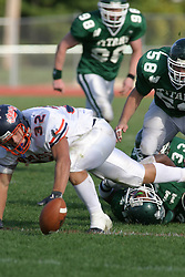 22 October 2005: Thunder Running Back Chaz Black lfor the ball he oses while being tackled. The Illinois Wesleyan Titans posted a 23 - 14 home win by squeeking past the Thunder of Wheaton College at Wilder Field (the 5th oldest collegiate field in the US) on the campus of Illinois Wesleyan University in Bloomington IL
