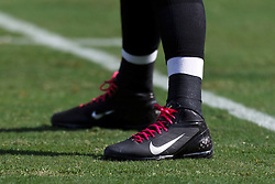 OAKLAND, CA - OCTOBER 21: General view of an Oakland Raiders football player wearing Nike cleats with pink laces in recognition of breast cancer awareness month before the game against the Jacksonville Jaguars at O.co Coliseum on October 21, 2012 in Oakland, California. The Oakland Raiders defeated the Jacksonville Jaguars 26-23 in overtime. Photo by Jason O. Watson/Getty Images) *** Local Caption ***