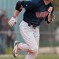 25 April 2010: Aaron Hornostaj of Rouen runs as he hits the ball during game 2/week 3 of the French Elite season won 12-0 by Rouen over the PUC, at the Pershing Stadium in Vincennes, near Paris, France.