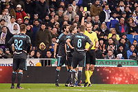 Referee show second yellow card to Real Sociedad's Iñigo Martinez during La Liga match between Real Madrid and Real Sociedad at Santiago Bernabeu Stadium in Madrid, Spain. January 29, 2017. (ALTERPHOTOS/BorjaB.Hojas)