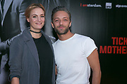 AMSTERDAM, THE NETHERLANDS. 2017, AUGUST 14. Tommie Christiaan and Michelle Splietelhof at the Dutch premiere of Hitman's Bodyguard at Pathe ArenA.