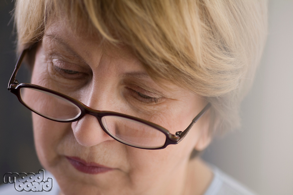 Mature woman in reading glasses