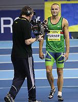 Photo: Rich Eaton.<br /> <br /> Norwich Union European Indoor Trials and UK Championships, Sheffield. 11/02/2007. Andy Turner of Sale is the focus of attention after winning the mens 60 metres hurdles
