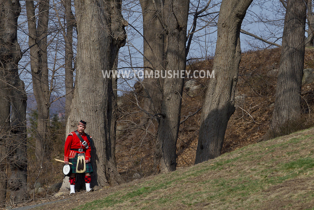 West Point, New York - A drummer watches other pipe and drum bands perform at the 32nd annual West Point Military Tattoo at Trophy Point at the United States Military Academy  on April 13, 2014.