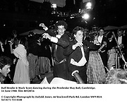 Raff Brodie &amp; Mark Scott dancing during the Pembroke May Ball, Cambridge. 14 June 1988. film 88528f16<br />
