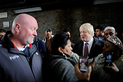The London Mayor Boris Johnson campaigning in the rain in Brixton during his Mayor Campaign, Wednesday April 25, 2012 Photo By Andrew Parsons /i-Images