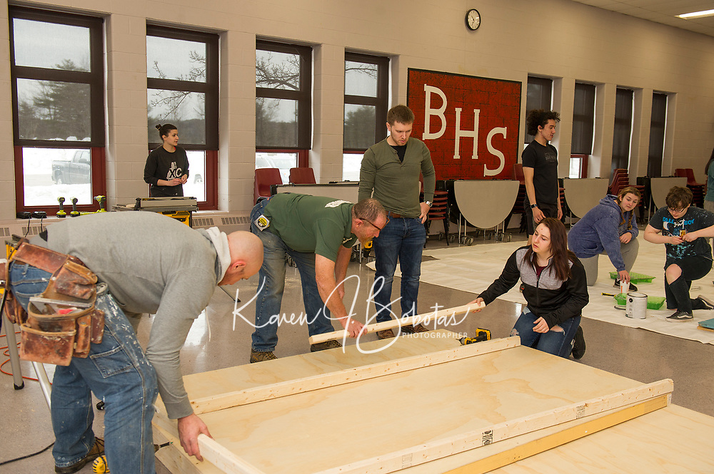 "Belmont High School students and volunteers work together to build the set for Once Upon a Mattress during ""Tech Day"" on Saturday morning.  (Karen Bobotas/for the Laconia Daily Sun)"
