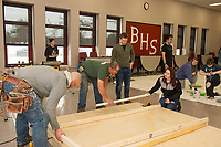 """Belmont High School students and volunteers work together to build the set for Once Upon a Mattress during """"Tech Day"""" on Saturday morning.  (Karen Bobotas/for the Laconia Daily Sun)"""